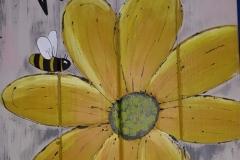 welkomstbord met gele bloem